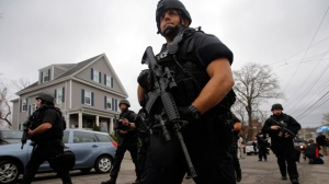 Boston Police search Watertown, MA.  (image from The Guardian website).